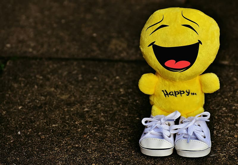 Portrait photography of yellow emoji wearing pair of white shoes