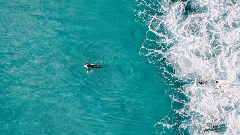 Man surfing on blue water