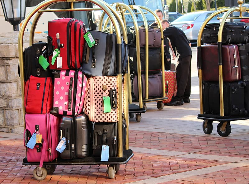 Person taking photo of assorted luggage bag lot