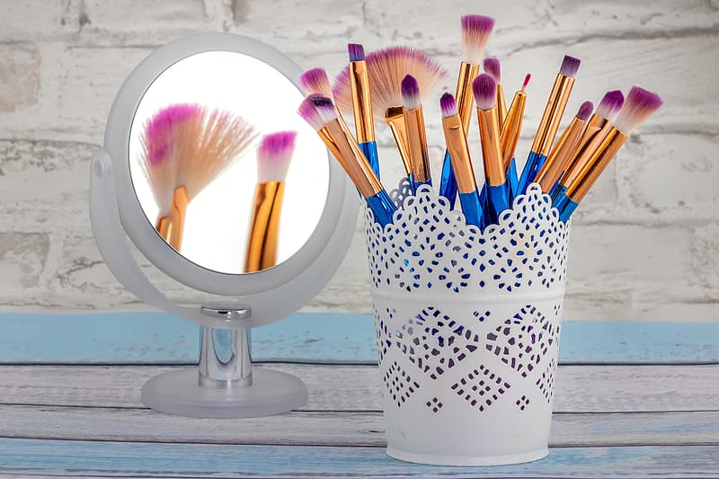 Paint brushes in white and black ceramic container