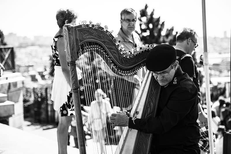 Man playing musical instrument in grayscale photography