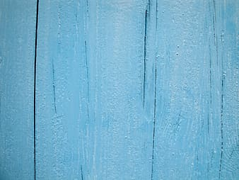 Blue wooden board with white paint