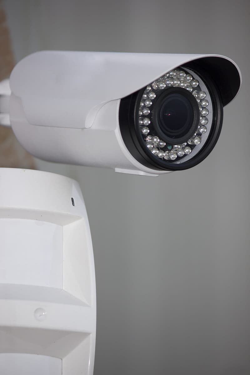 White and black security camera