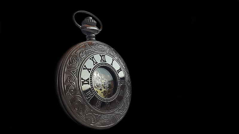 Round silver-colored framed pocket watch with black background