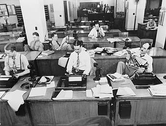 Group of people on desk in gray scale