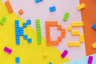 Flat-lay photography of kids-spelled interlocking toy block