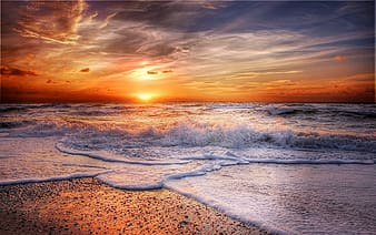 Seashore and ocean sunset photo