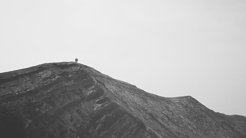 Two people standing on rock formation