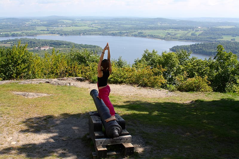 Woman doing yoga post standing on cannon