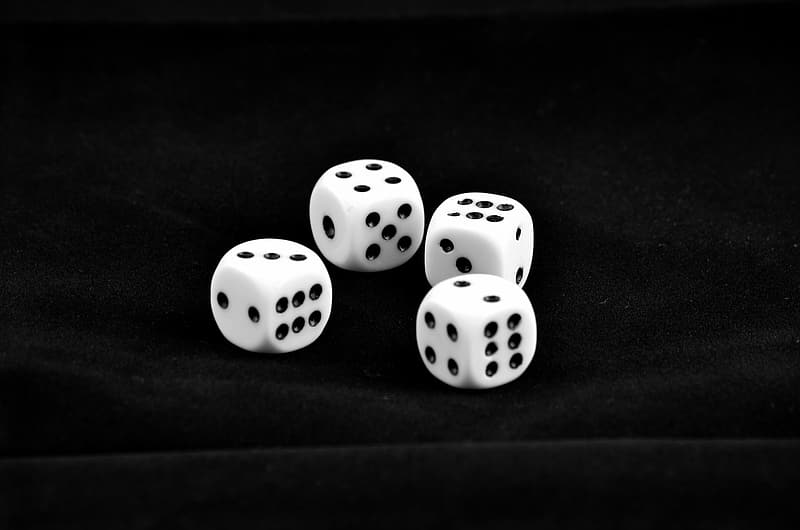 Four black-and-white dices