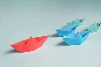 Red and blue origami boats