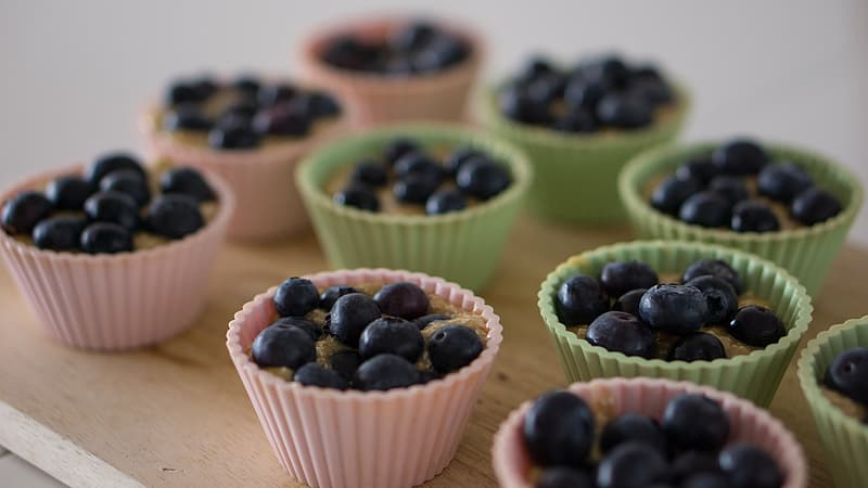 Cupcakes with berries on brown paper
