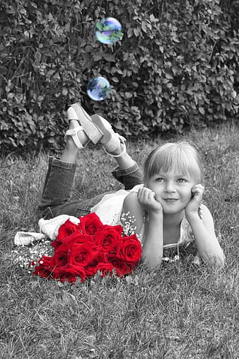 Selective photography of red flowers near smiling girl
