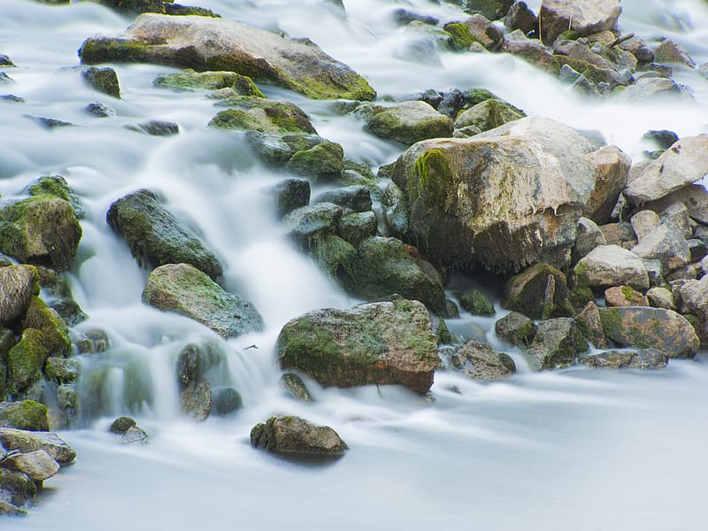 Time-lapse photography of waterfalls on rocks