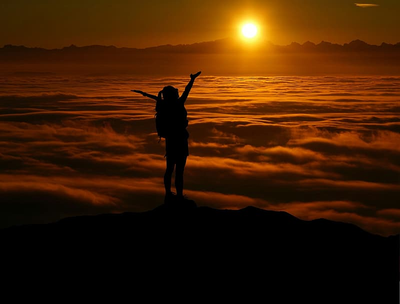 Person standing on sea of clouds