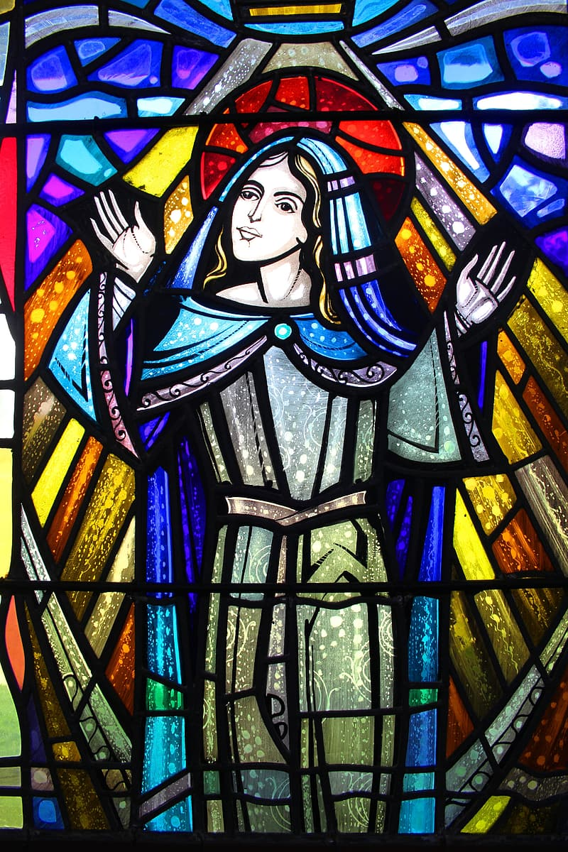 Blue, red, and yellow religious figure stained glass