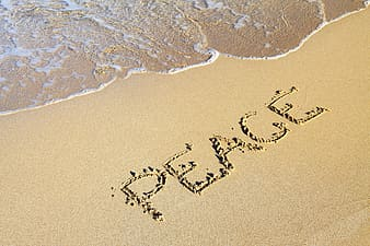 Brown sand written with peace text