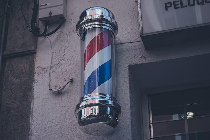 Barber's pole on wall near window