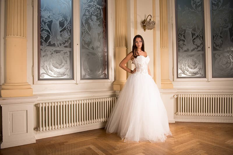 Woman wearing white floral sweetheart neckline wedding gown