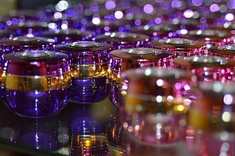 Selective focus photography of purple-and-blue glasses