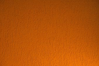 Orange painted wall with white paint