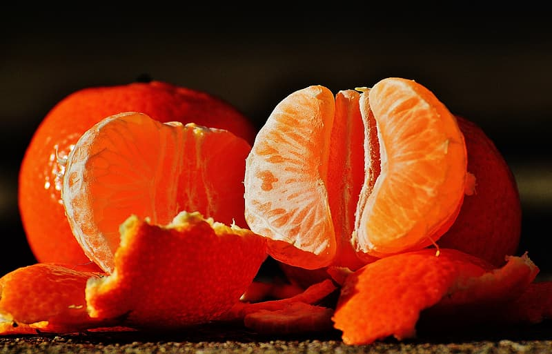 Peeled orange fruits still life photography