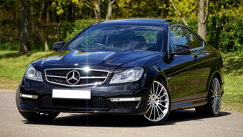 Black Mercedes-Benz coupe on road during daytime