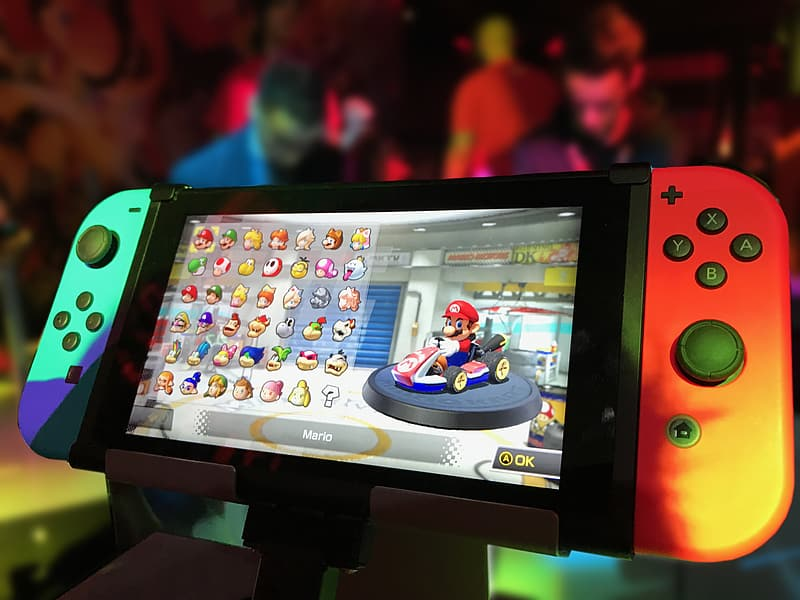 Turned on Nintendo Switch with Joy-Con and Super Mario game display