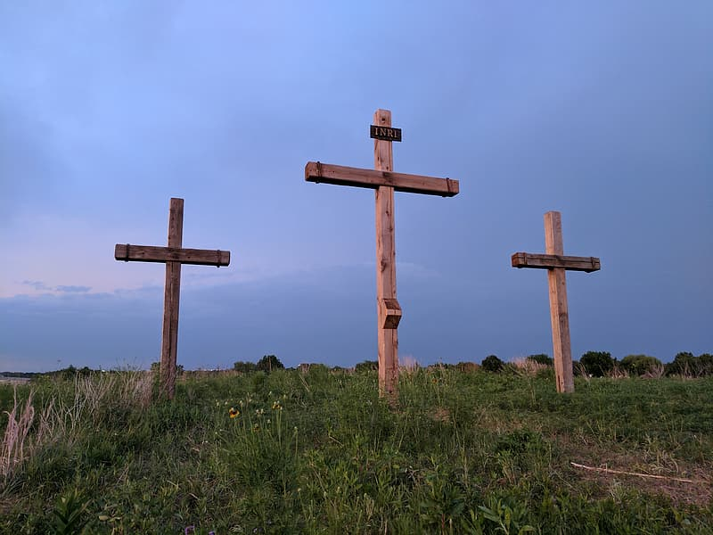 Brown wooden cross during daytime