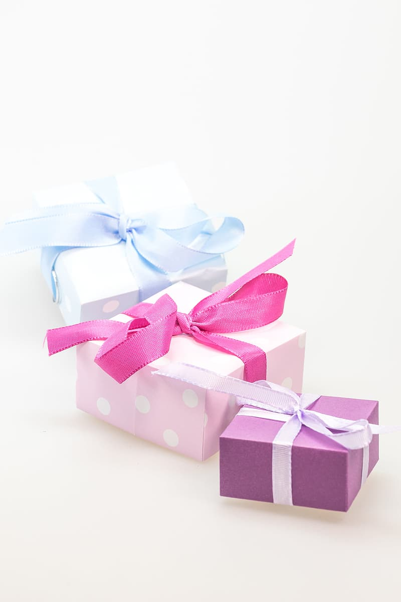 Three assorted-color gift boxes