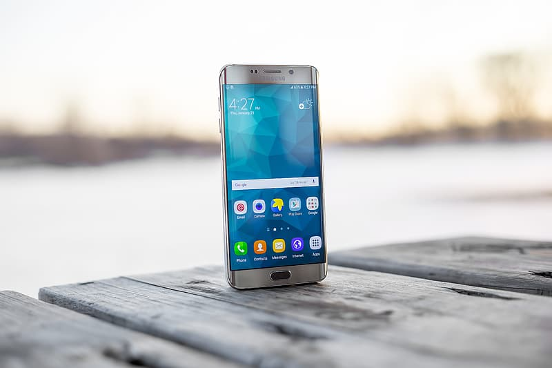 Silver samsung galaxys 6 edge on brown wooden table