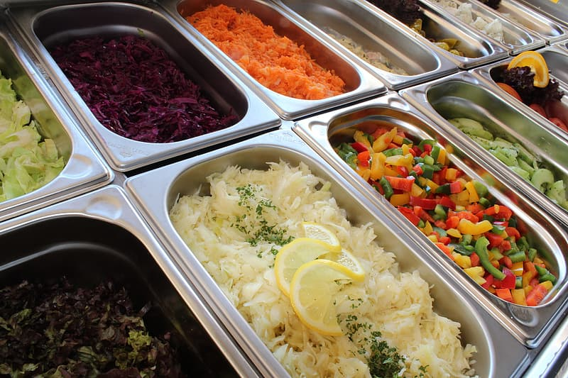 Variety of cooked foods in bain-marie