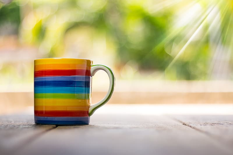 White and multicolored rainbow print ceramic mug