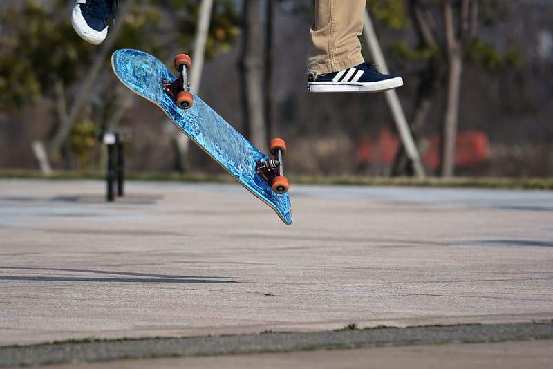Person in blue and white nike sneakers riding skateboard