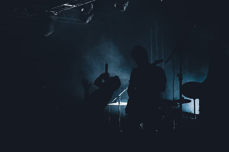 Silhoutte of men playing musical instruments