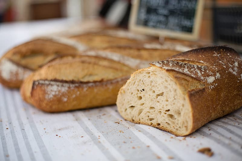 Baked breads on white and gray striped surface