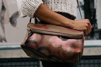 Person wearing brown leather crossbody bag