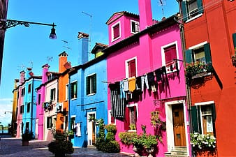 Pink, orange, blue, and white houses