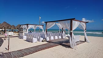 White canopy with brown wooden frames during daytime