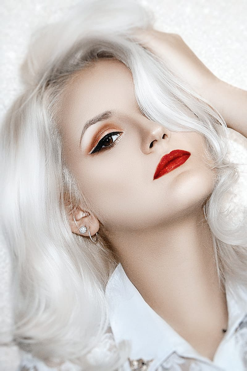 Woman with red lipstick and blonde hair