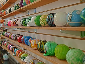 Assorted-color plastic toy lot on shelves