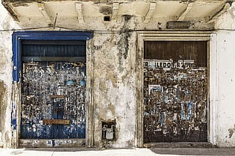 Two brown and blue wooden doors