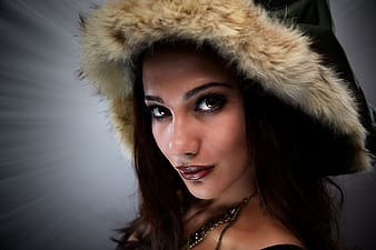 Woman wearing black and beige furred hat