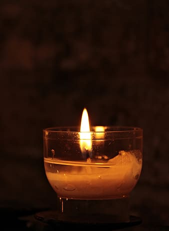 Tealight candle with flame