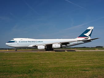 Cathay Pacific Cargo plane under blue sky