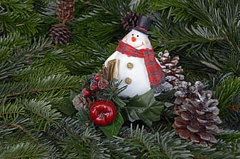 Snowman bauble and pinecones