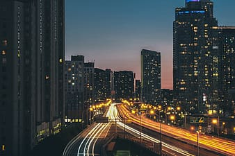 Time lapse photography of light and buildings at nighttime