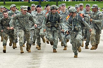 Army running on concrete road during daytime