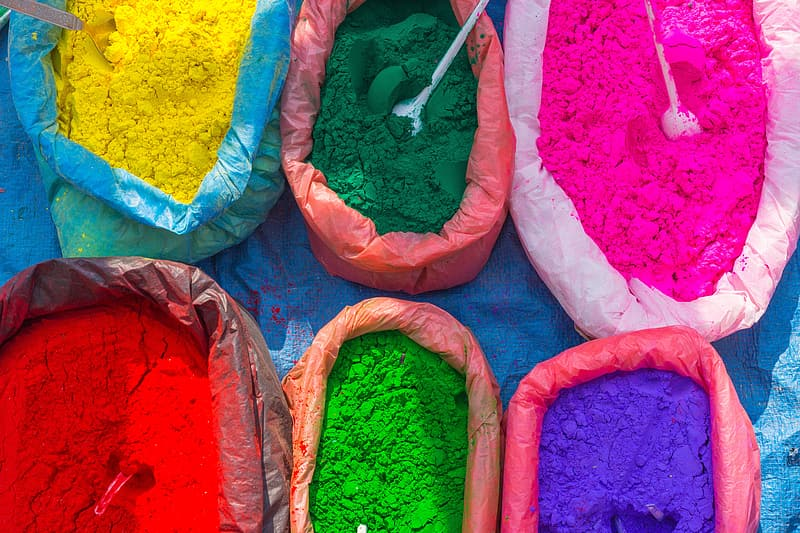 Green, red, and purple powders