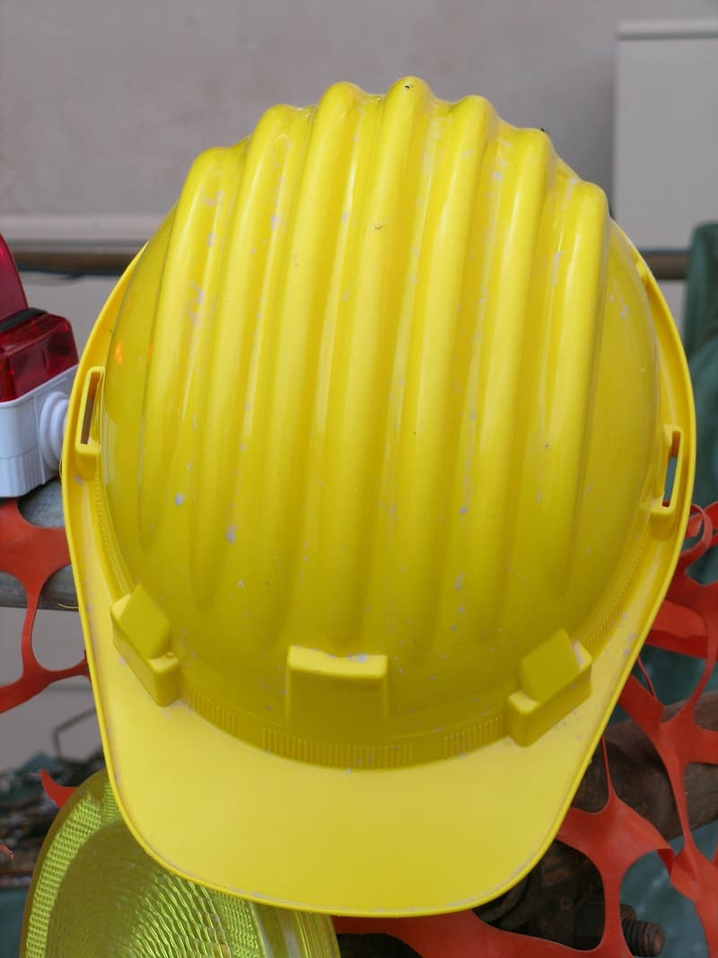 Yellow hard hat on red plastic container